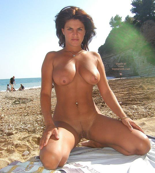 Muscle women on beach naked