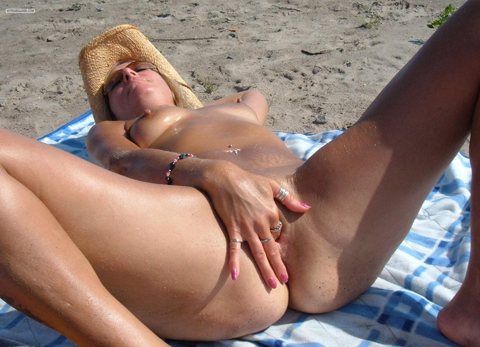 Women fingering at nude beach