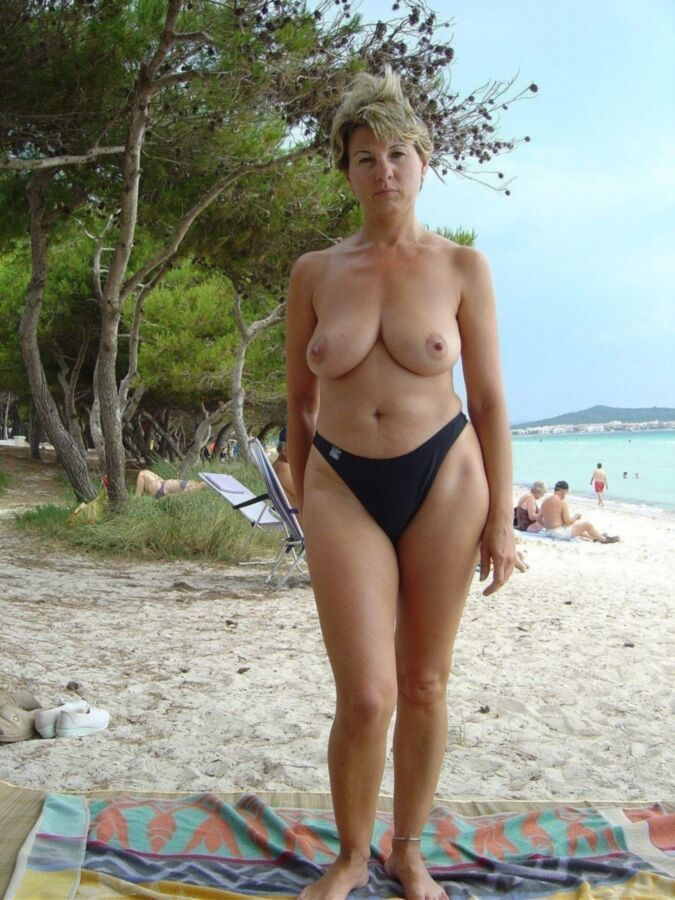 Beach mom topless